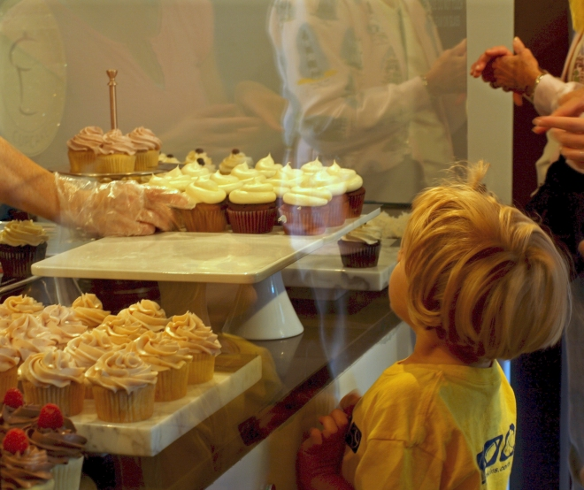 Girl looking at cupcakes